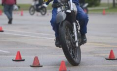 Close up of rider going through pylon course at motorcycle school.